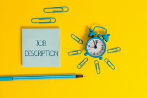 job description on notepad with paper