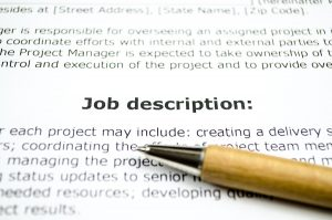 job description words on paper with pencil