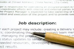 job description words on paper with pencil
