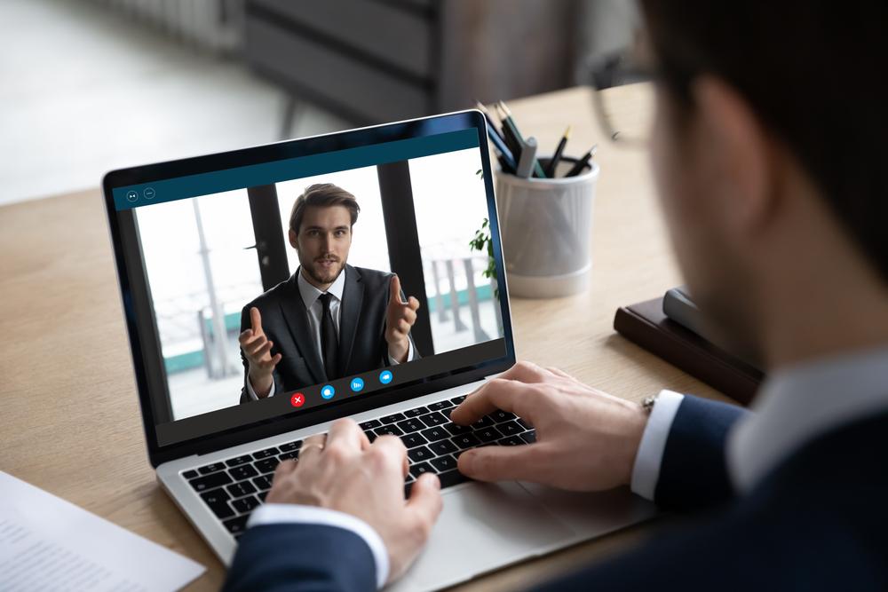video meeting man on laptop