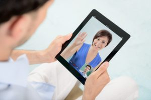 video meeting woman on tablet