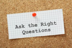 Ask the right questions paper on bulletin board