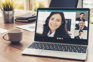 woman on laptop for virtual meeting