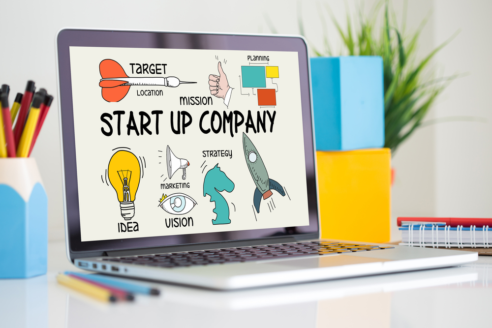 start up company image on laptop screen